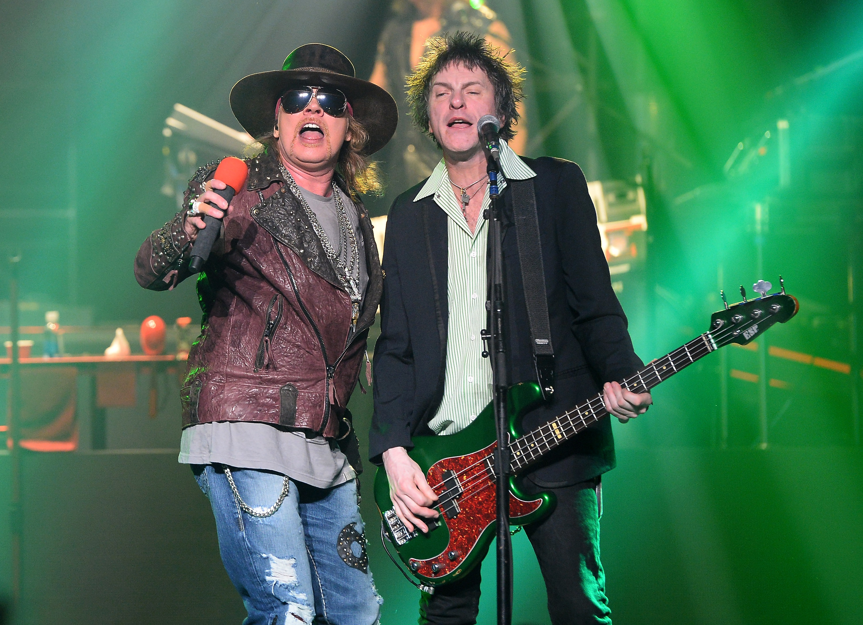Axl Rose and Tommy Stinson playing with Guns N' Roses. (Photo by Ethan Miller/Getty Images)