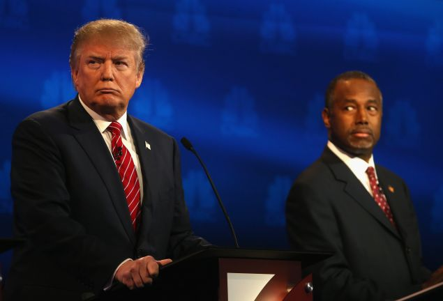 Then-candidates Donald Trump and Dr. Ben Carson during the CNBC Republican Presidential debate at the University of Colorados at Boulder in October 2015.