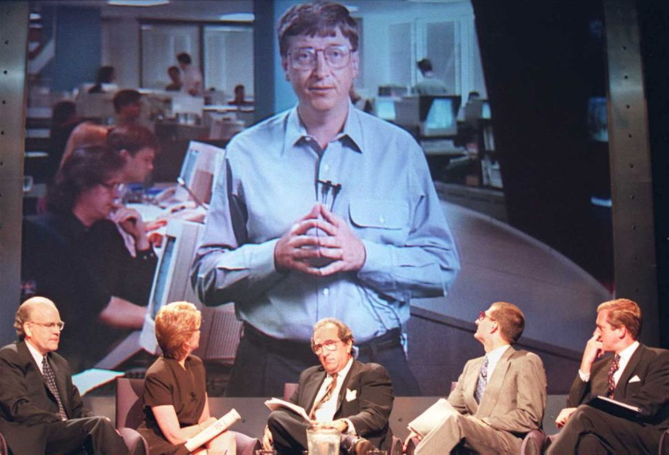 Imagine Bill Gates had never pursued his endeavors, that Microsoft had never existed. Would the world be a better or richer place? Microsoft CEO Bill Gates appears on a large screen TV during a press conference with (seated L-R) NBC CEO Bob Wright, NBC journalist Jane Pauley, NBC News President Andrew Lack, Microsoft Strategic Partnerships Vice President Peter Neupert, and NBC journalist Brian Williams 15 July in New York. Gates joined the press conference on a live connection from Washington state to launch the 24 hour NBC Microsoft television news channel. (Photo credit should read )