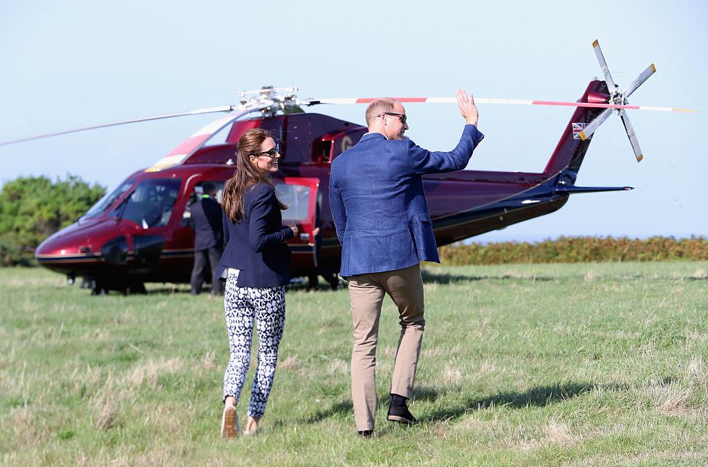 Prince William, Duke of Cambridge and Catherine, Duchess of Cambridge wave as they head back to the Royal helicopter after visiting the Island of St Martin's in the Scilly Isles on September 2, 2016 in St Martins, England. The Duke and Duches's visit to the Scilly Isles was delayed this morning due to bad weather. (Photo by Chris Jackson - WPA Pool/Getty Images)