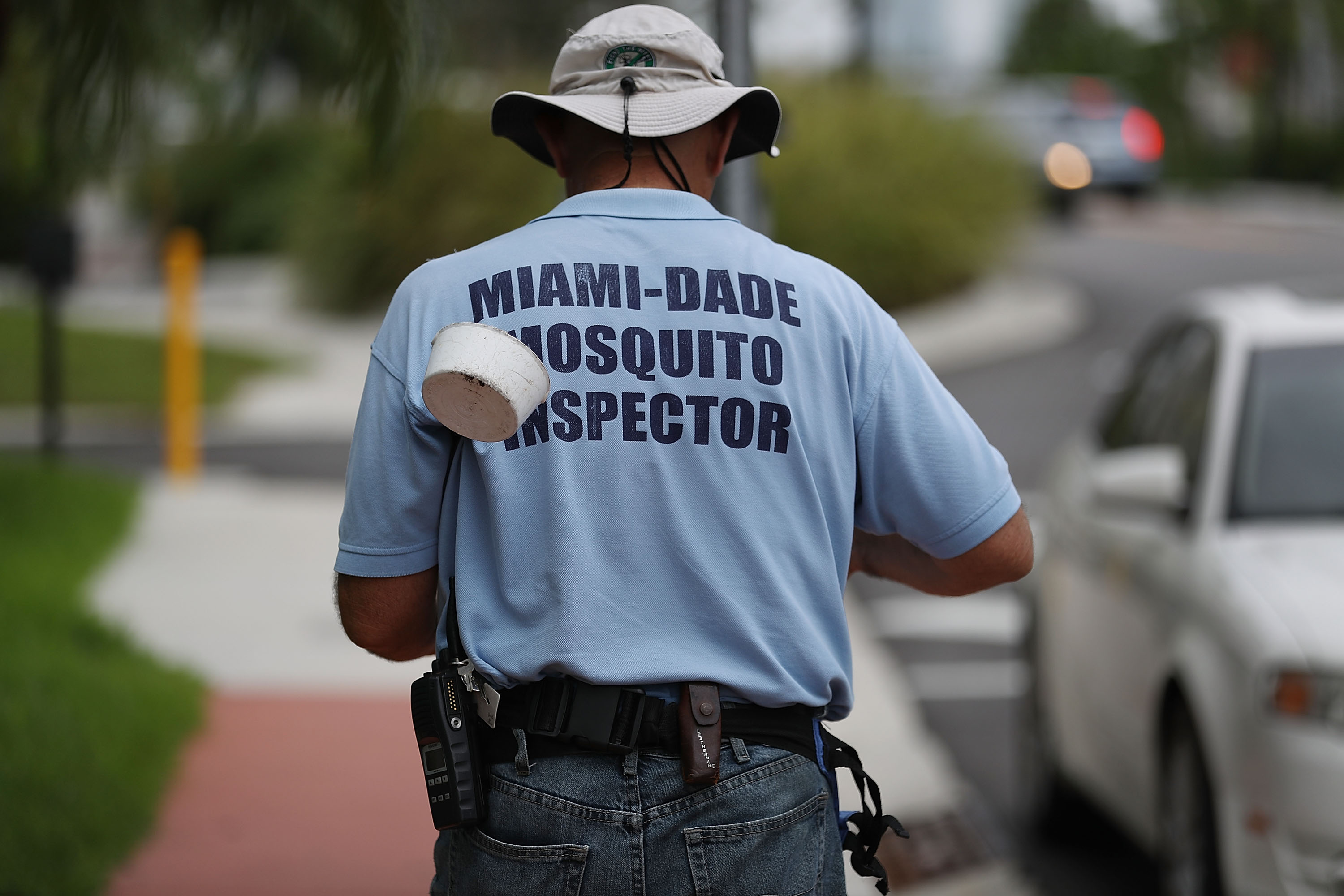 A Miami-Dade County mosquito control inspector, walks through the streets looking for places that might hold breeding mosquitos that are carrying the Zika virus on September 2, 2016 in Miami Beach, Florida.
