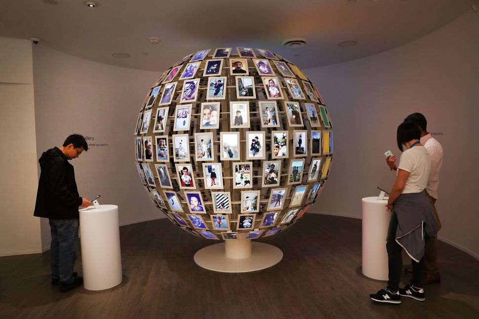 NEW YORK, NY - OCTOBER 20: People visit the new Google pop-up shop in the SoHo neighborhood on October 20, 2016 in New York City. The shop lets people try out new Google products such as the Pixel phone, Google Home, and Daydream VR. The products will be available for purchase offsite at Verizon and Best Buy retail stores.