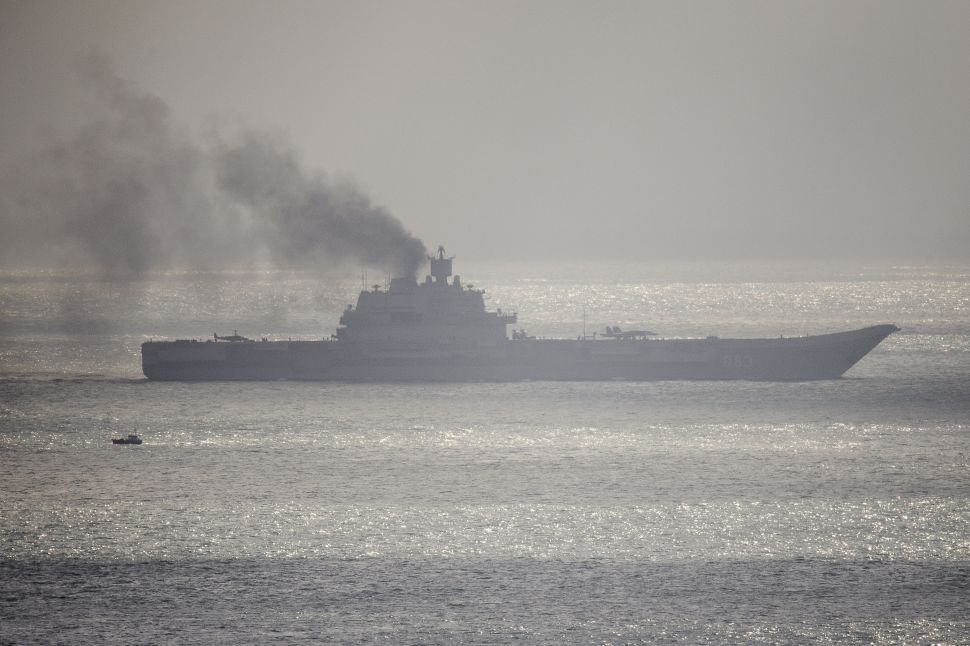 DOVER, ENGLAND - OCTOBER 21: The Russian aircraft carrier Admiral Kuznetsov passes through the English channel on October 21, 2016 near Dover, England. The Russian Navy's flotilla of warships is presumed to be heading to the eastern Mediterranean to support the Russian military's current deployment in Syria.