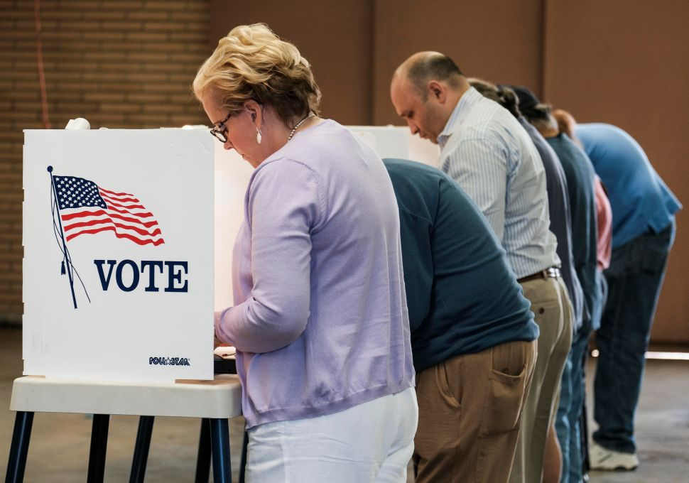 Voters cast their ballots in the US presidential election at a fire station in Alhambra, California, on November 8, 2016.
