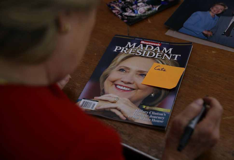 Hillary Clinton signs Newsweek 'Madam President' commemorative magazine on November 7, 2016. Clinton lost the election to Republican nominee Donald Trump.