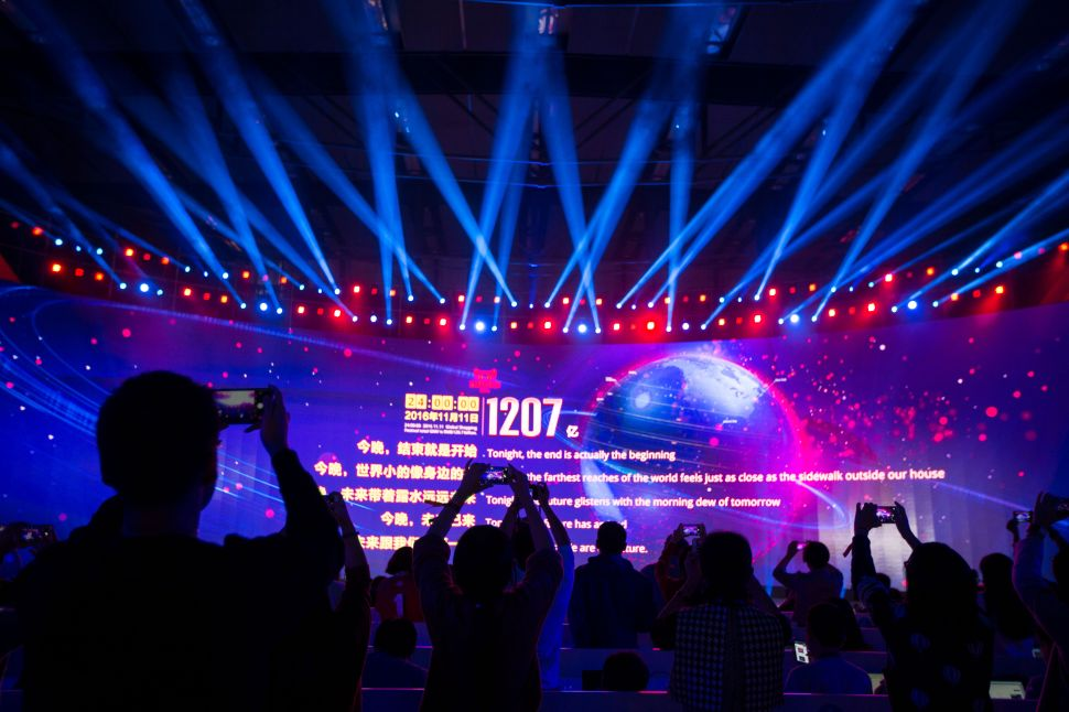 A large screen shows the final total gross merchandise volume, a measure of sales, after 24 hours of Singles Day sales, at the Tmall 11:11 Global Shopping Festival gala in Shenzhen, in south China's Guangdong province early on November 12, 2016.