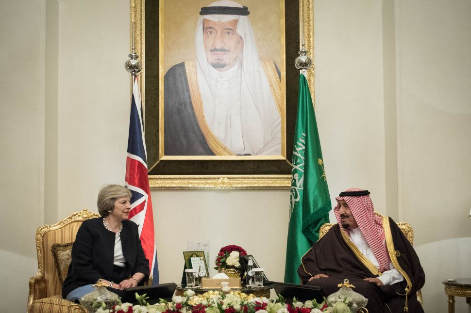 British Prime Minister Theresa May meets King Salman bin Abdulaziz al Saud of Saudi Arabia on December 6, 2016.