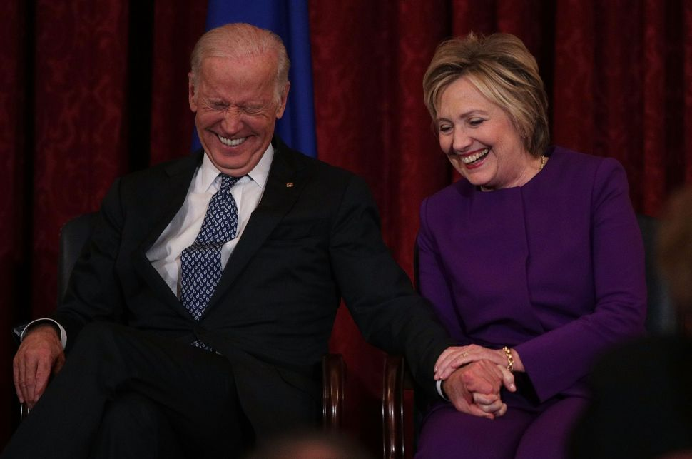 WASHINGTON, DC - DECEMBER 08: Former U.S. Secretary of State Hillary Clinton (R) shares a moment with Vice President Joseph Biden (L) during a leadership portrait unveiling ceremony for Senate Minority Leader Sen. Harry Reid (D-NV) December 8, 2016 on Capitol Hill in Washington, DC. The leadership portrait unveiling ceremony was held to honor the outgoing Democratic leader.