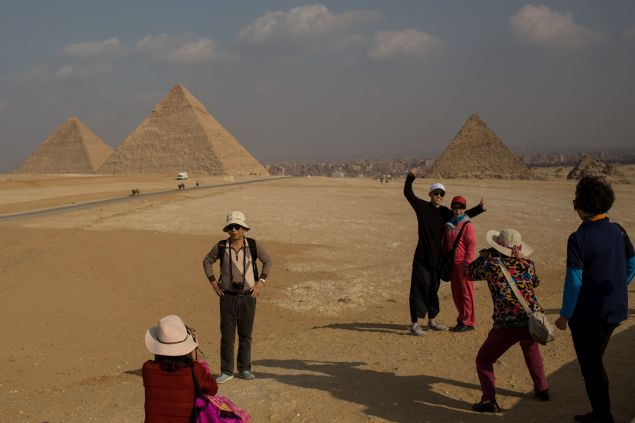 Tourists take photographs in front of Egypt's famous Giza Pyramids on December 18, 2016 in Cairo, Egypt. Since the 2011 Arab Spring and continued terrorist attacks throughout the country, Egypt's tourism industry has been hit hard. As the country tries to rebuild a damaged economy and revive the tourism industry, an increase in terrorists attacks in the past two weeks, one which targeted police officers at a checkpoint in the Giza neighbourhood, could continue to see the tourism industry suffer.
