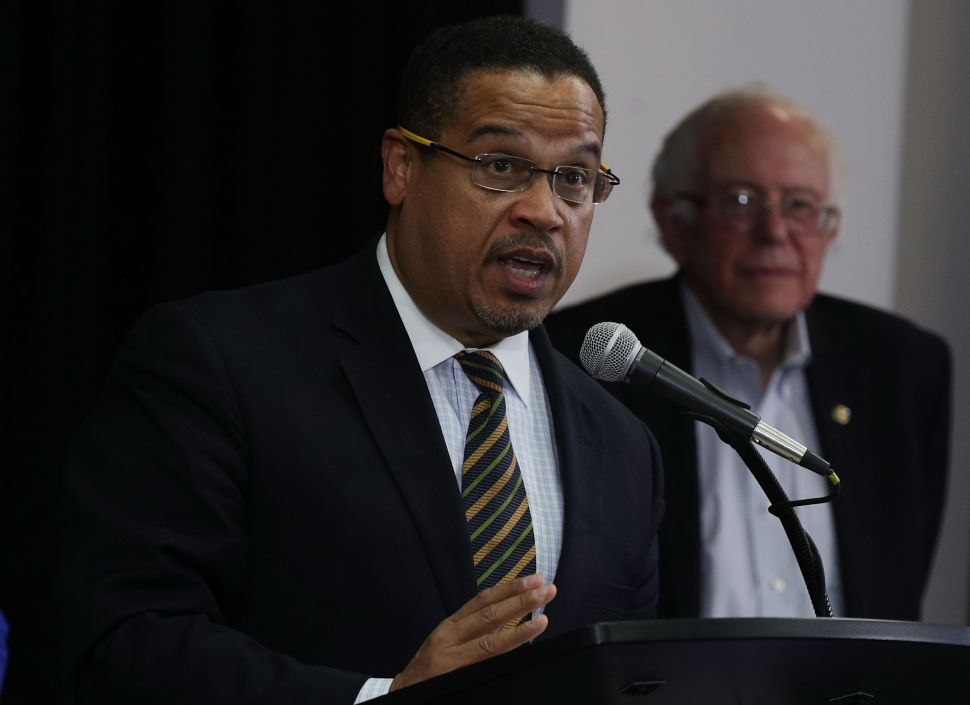 U.S. Rep. Keith Ellison speaks as Sen. Bernie Sanders listens during an event that was held to outline Ellison's vision as he campaigns to become the next chairman of the Democratic National Committee.