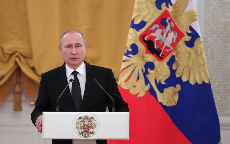 Russian President Vladimir Putin delivers a speech during a reception dedicated to the celebration of the New Year at the Kremlin in Moscow on December 28, 2016. / AFP / Sputnik / Michael Klimentyev