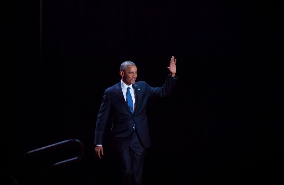 President Barack Obama walks on stage to deliver his farewell speech on January 10, 2017 in Chicago, Illinois.