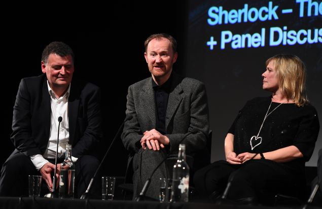 Steven Moffat, Mark Gatiss and Sue Vertue at a Sherlock panel.