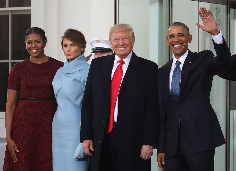 WASHINGTON, DC - JANUARY 20: President-elect Donald Trump (2ndR),and his wife Melania Trump (2ndL), are greeted by President Barack Obama and his wife first lady Michelle Obama, upon arriving at the White House on January 20, 2017 in Washington, DC. Later in the morning President-elect Trump will be sworn in as the nation's 45th president during an inaugural ceremony at the U.S. Capitol.
