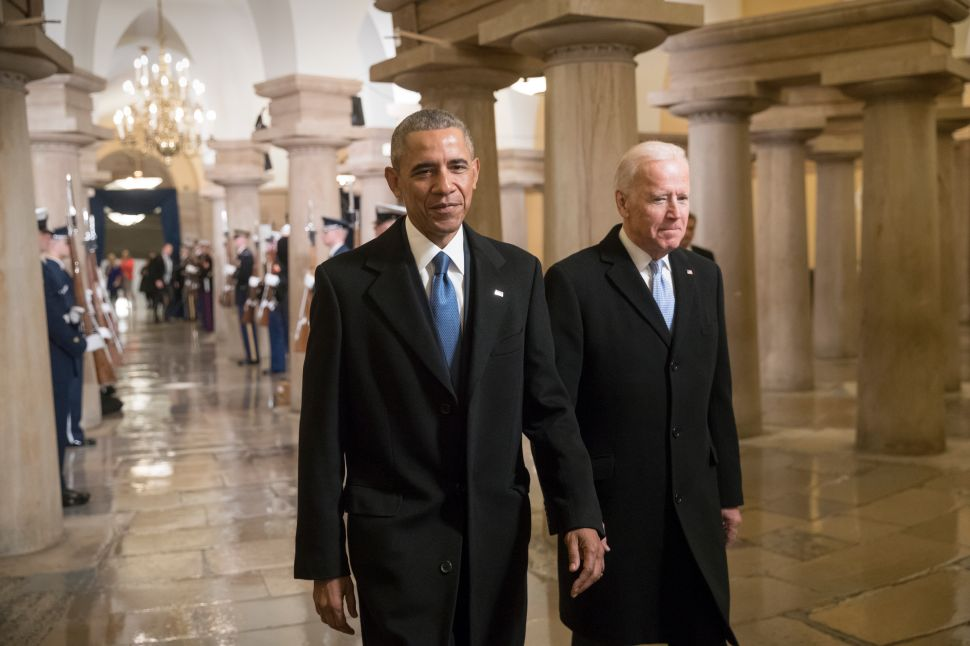 WASHINGTON, DC - JANUARY 20: President Barack Obama and Vice President Joe Biden walk through the Crypt of the Capitol for Donald Trump's inauguration ceremony, in Washington, January 20, 2017.