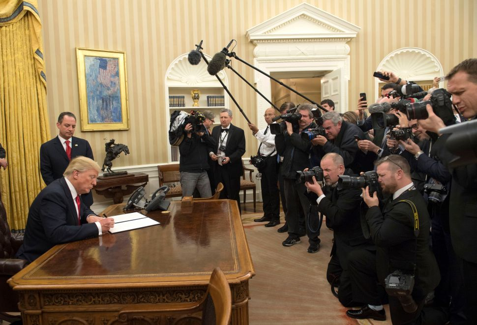 WASHINGTON, DC - JANUARY 20: President Donald Trump signs his first executive order as president, ordering federal agencies to ease the burden of President Barack Obama's Affordable Care Act January 20, 2017 in Washington, DC.