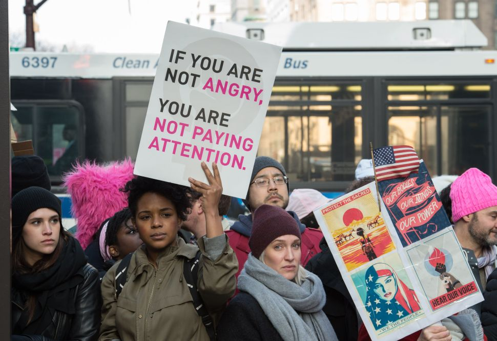 People are blocked from passing Trump Tower during the Women's March in New York City on January 21, 2017. Hundreds of thousands of people flooded US cities Saturday in a day of women's rights protests to mark President Donald Trump's first full day in office. / AFP / Bryan R. Smith