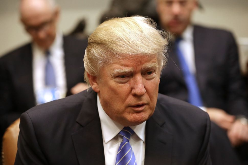 WASHINGTON, DC - JANUARY 23: U.S. President Donald Trump (C) delivers opening remarks during a meeting with business leaders in the Roosevelt Room at the White House January 23, 2017 in Washington, DC. Business leaders included Elon Musk of SpaceX, Mark Sutton of International Paper, Andrew Liveris of Dow Chemical, Mario Longhi of US Steel, Marillyn Hewson of Lockheed Martin, Wendell Weeks of Corning, Alex Gorsky of Johnson & Johnson, Michael Dell of Dell Technologies and others.