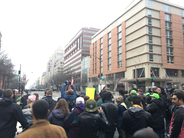 Protesters and police officers with riot gear on K Street between 11th and 12th streets in Washington, D.C.