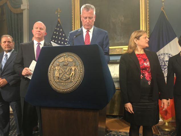 Mayor Bill de Blasio, flanked on the left by Police Commissioner James O'Neill and on his right by Council Speaker Melissa Mark-Viverito.