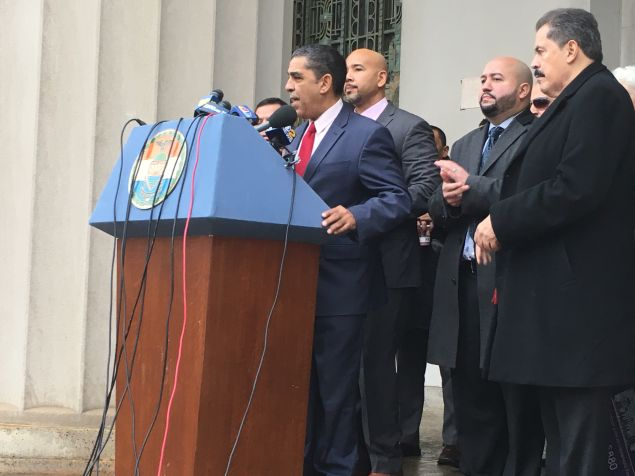Congressman Adriano Espaillat speaks at a press conference against President Donald Trump's sanctuary city order on the steps of the Bronx County building.