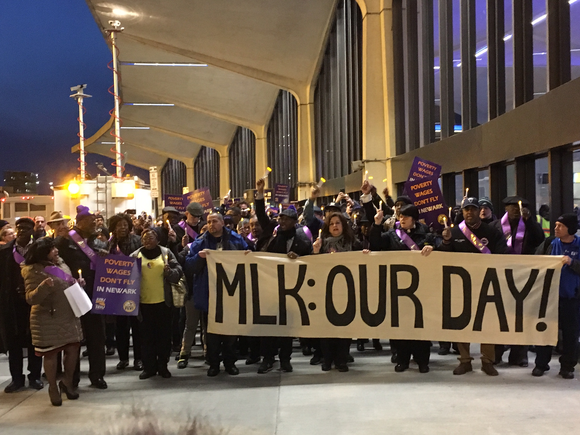 Airport workers rally for a higher minimum wage.