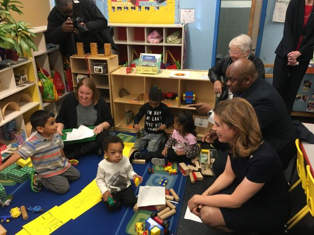 Deputy Mayor of Strategic Initiatives Richard Buery greets children at PS 171, where the city kicked off the pilot program for the NYC Child Savings Account for college.