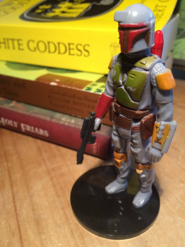 A Boba Fett action figure. Just standing there, like the real Boba Fett