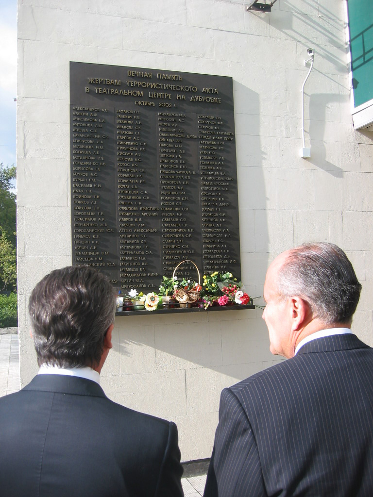 In Sept, 2004, Rudy Giuliani visited the memorial to the victims of the 2002 Nord-Ost siege at a theater in Moscow. Note the presence of a security camera above the plaque listing the victims.
