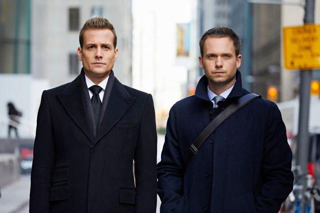Gabriel Macht as Harvey Specter and Patrick J. Adams as Michael Ross.