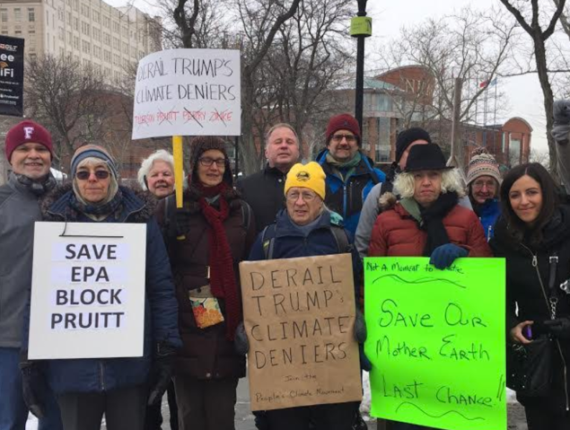Demonstrators and environmental groups gathered Monday in Newark to protest president-elect Donald Trump's cabinet appointees.