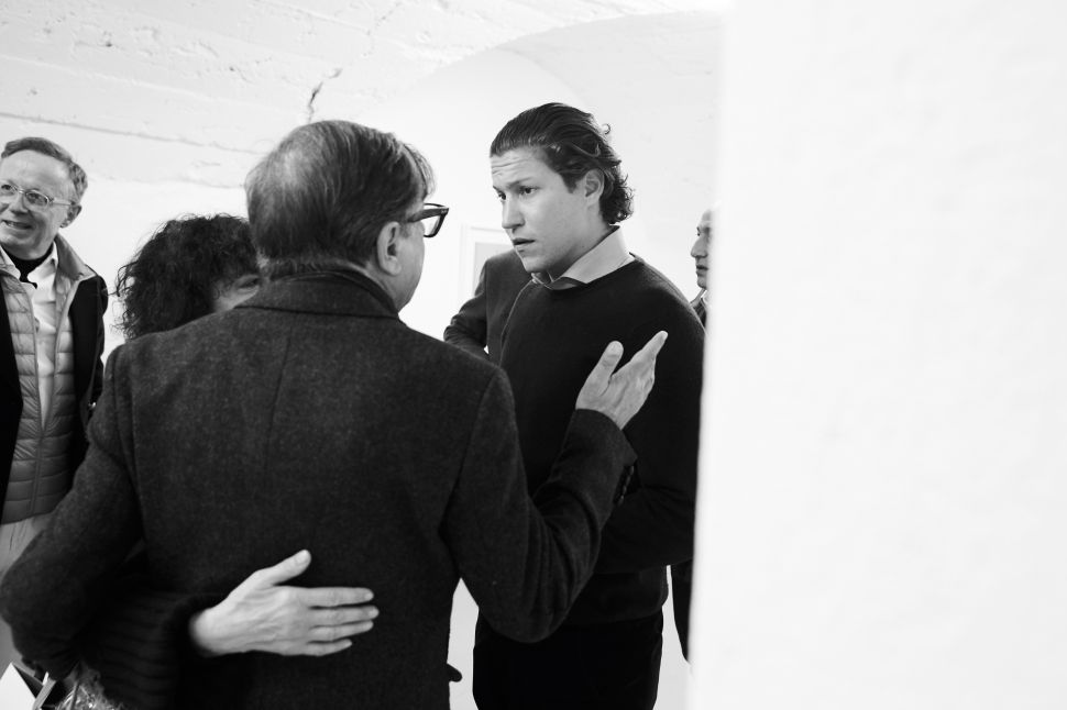 "Georg Frei, Bob Colacello, Vito Schnabel chat at the opening celebration for ""Age of Ambiguity."""