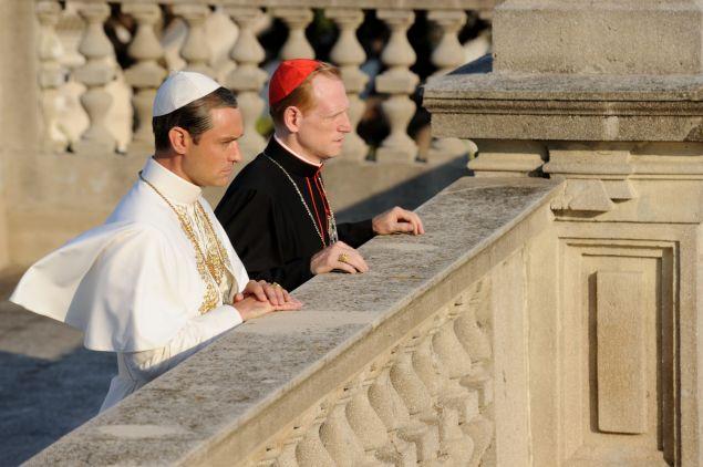 Jude Law as Lenny Belardo and Scott Shepherd as Cardinal Dussolier.