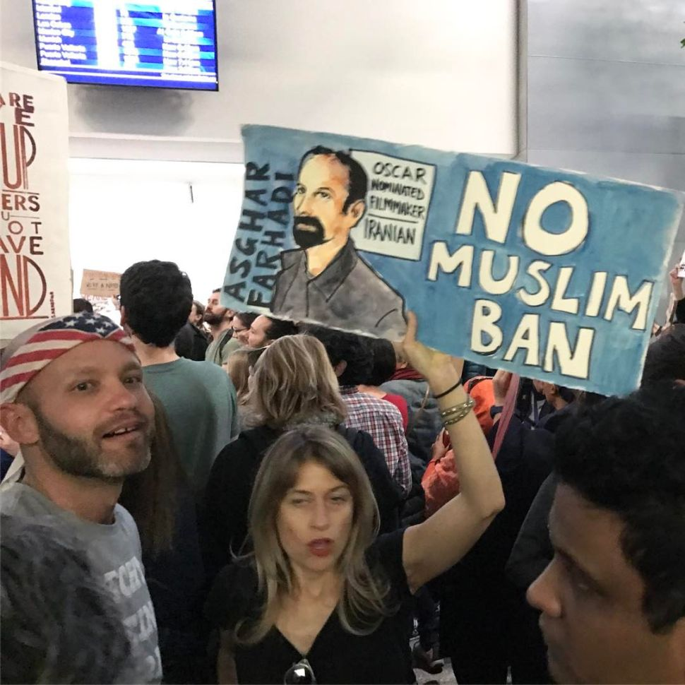 The picture was taken by Ahmad Kiarostami at #nobannowall protests at SFO international airport on January 28, 2017. Ahmad Kiarostami is the son of award-winning Iranian auteur, Abbas Kiarostami, who died in July 2016.