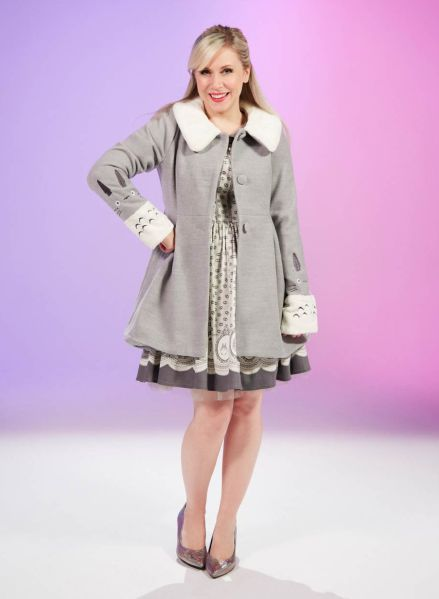 Studio Ghibli's beloved character, Totoro, is featured on this button front closure coat, featuring a fluffy white collar and sleeves with embroidered Totoro detail. Available at Heruniverse.com.