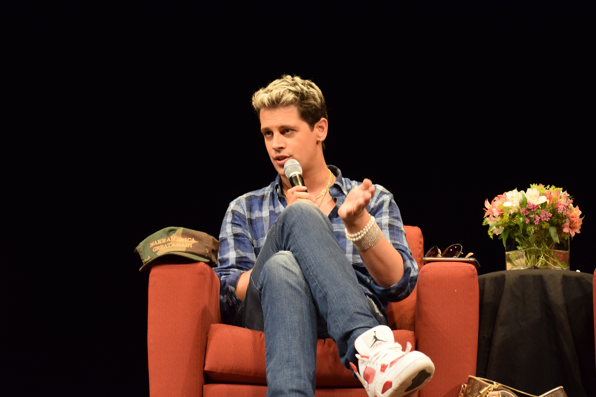 Milo Yiannopoulos on stage.
