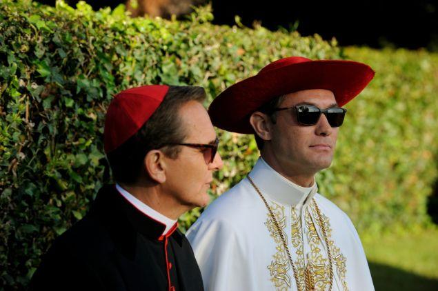 Sebastian Roché as Cardinal Michel Marivaux and Jude Law as Lenny Belardo.