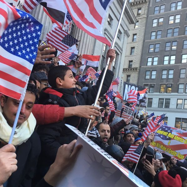 "A young boy chants ""USA!"" enthusiastically at the Yemeni bodega owner rally against President Donald Trump's Muslim travel ban."
