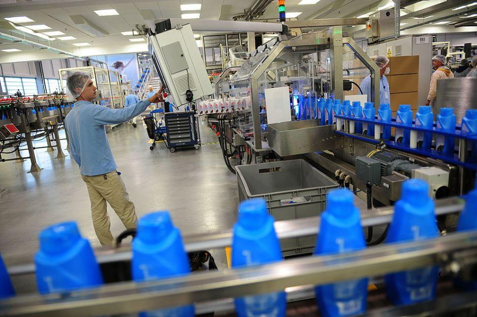A Romanian employee surveys a production line at a Procter & Gamble plant in Bucharest.