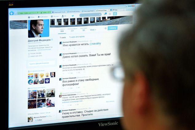 """A man looks at the computer screen with a page of Russian Prime Minister Dmitry Medvedev in Twitter in Moscow on August 14, 2014. Hackers broke into Medvedev's Twitter account on Thursday, tweeting his resignation and criticising President Vladimir Putin. """"Microblog of the Premier in """" Twitter """" hacked, recent reports are not true,"""" the press service of the Cabinet told Russian """"Interfax"""" news agency. AFP PHOTO / YURI KADOBNOV (Photo credit should read YURI KADOBNOV/AFP/Getty Images)"""