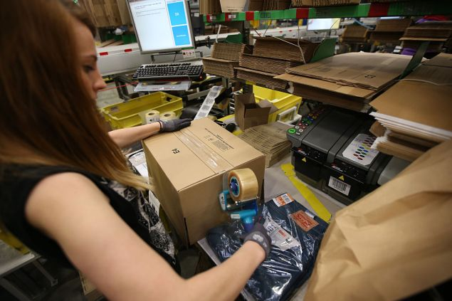 HEMEL HEMPSTEAD, ENGLAND - DECEMBER 05: A parcel is prepared for dispatch at Amazon's warehouse on December 5, 2014 in Hemel Hempstead, England. In the lead up to Christmas, Amazon is experiencing the busiest time of the year. (Photo by Peter Macdiarmid/Getty Images)