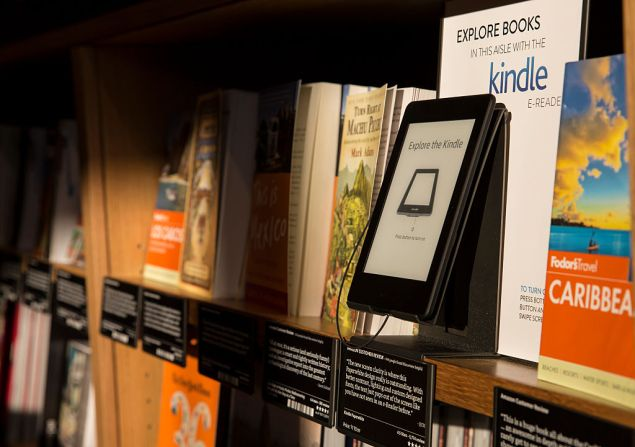 SEATTLE, WA - NOVEMBER 4: Books are displayed along side an Amazon Kindle device, which offers previews of those same books on nearby shelves at the Amazon Books store on November 4, 2015 in Seattle, Washington. The online retailer opened its first brick-and-mortar book store on November 3, 2015. (Photo by Stephen Brashear/Getty Images)