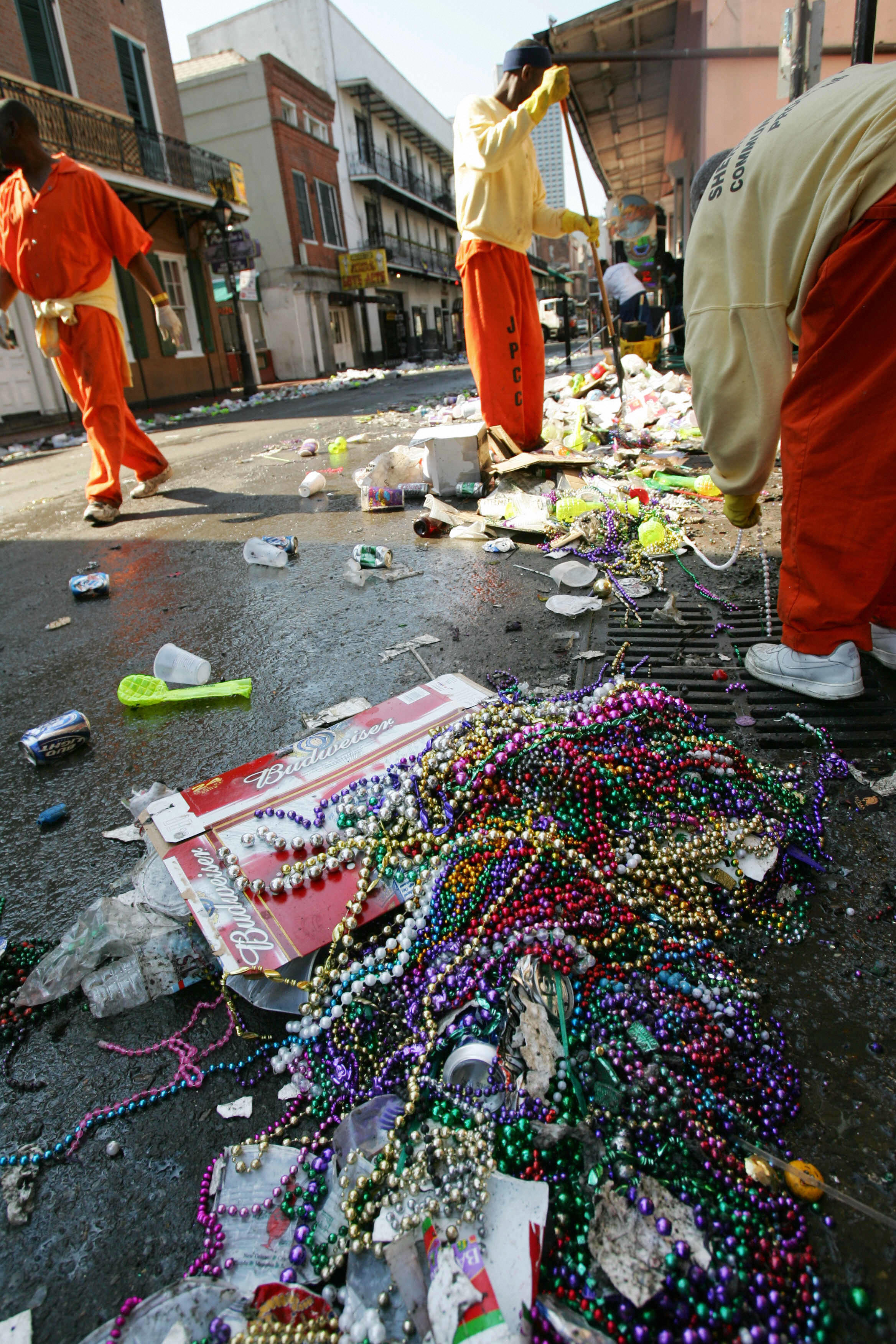 New Orleans, UNITED STATES: Inmates from a community service program clean Bourbon Street 01 March 2006 in the French Quarter of New Orleans, one day after Mardi Gras. It was New Orlean's first Mardi Gras since Hurricane Katrina. AFP PHOTO / Robyn Beck (Photo credit should read )