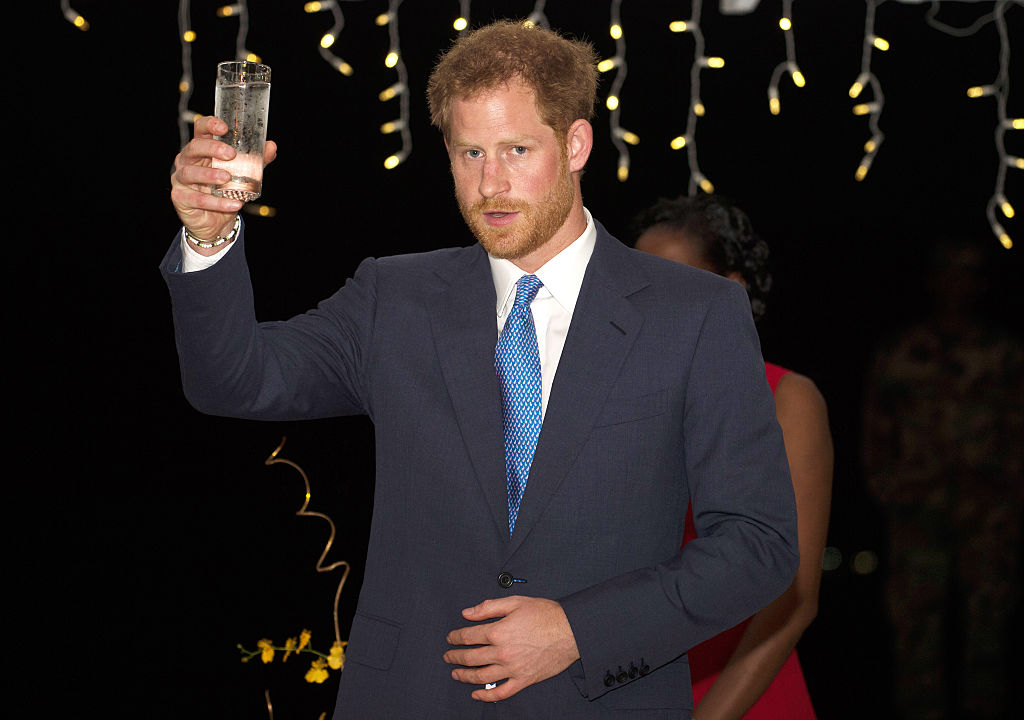 GRAND ANSE BEACH, GRENADA - NOVEMBER 29: Prince Harry speaks at a reception at the Spice Island Beach Resort before attending a reception hosted by the Governor General Her Excellency Dame Cecile La Grenade, on November 29, 2016 in Grenada. Prince Harry's visit to The Caribbean marks the 35th Anniversary of Independence in Antigua and Barbuda and the 50th Anniversary of Independence in Barbados and Guyana. (Photo by Paul Edwards - Pool /Getty Images)