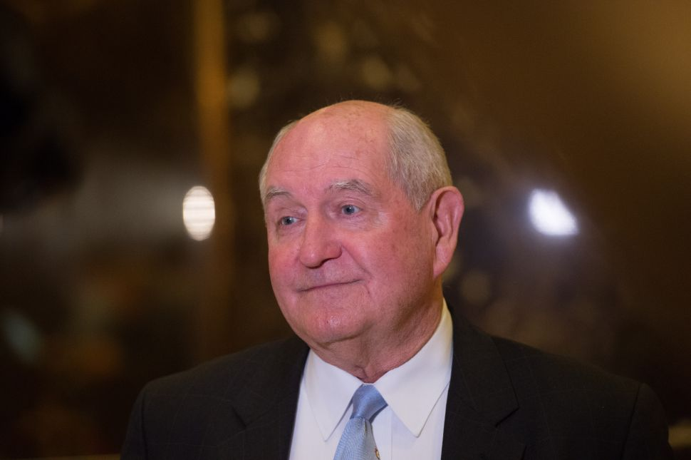 Former Georgia governor Sonny Perdue speaks to the media in the lobby of Trump Tower.
