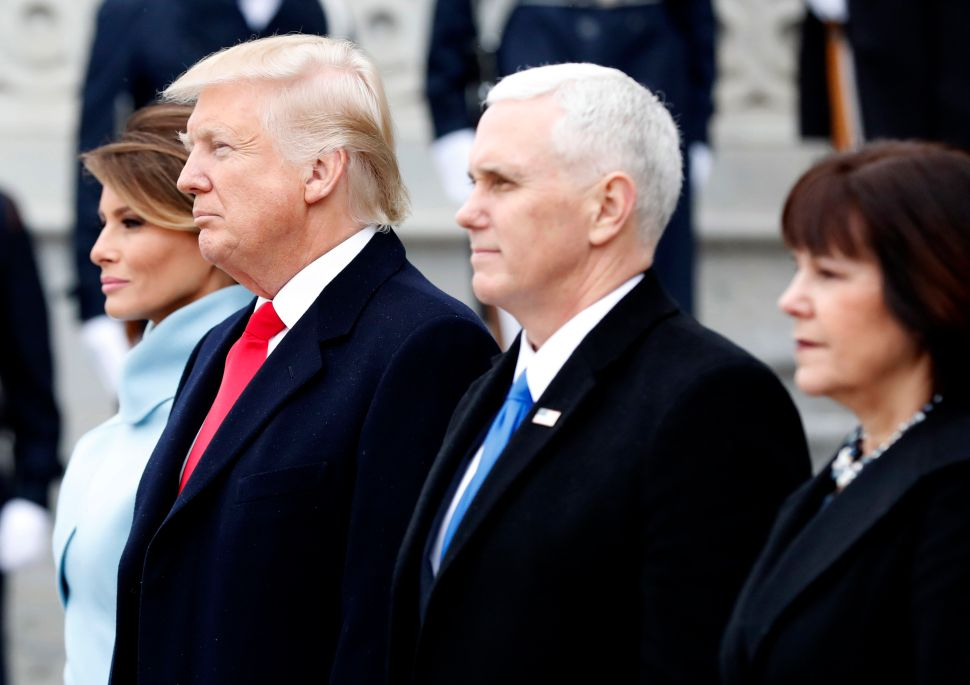 President Donald Trump, First Lady Melania Trump, Vice President Mike Pence and Karen Pence stand on front steps of the Capitol Building.
