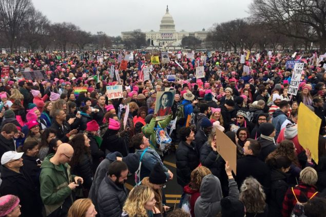 Demonstrators protest on the National Mall in Washington, DC, for the Women's march on January 21, 2017. Hundreds of thousands of protesters spearheaded by women's rights groups demonstrated across the US to send a defiant message to US President Donald Trump.