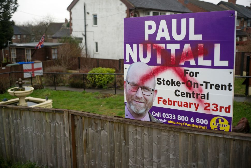 A campaign poster for UKIP candidate Paul Nuttall is defaced in Stoke-on-Trent, England. The city has been dubbed the Brexit capital of Britain after it recorded the highest percentage of 'vote leave' votes in the country.