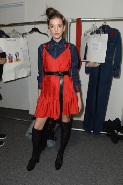 A backstage red moment at Adam Selman.