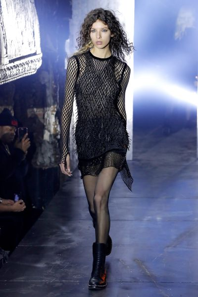 A black on black fishnet dress.